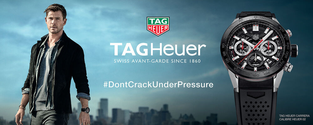 TAG Heuer -- Swiss Avant-Garde Since 1860. #DontCrackUnderPressure. Picture of Chris Hemsworth, TAG logo and TAG Heuer Carrera Calibre Heuer 02.