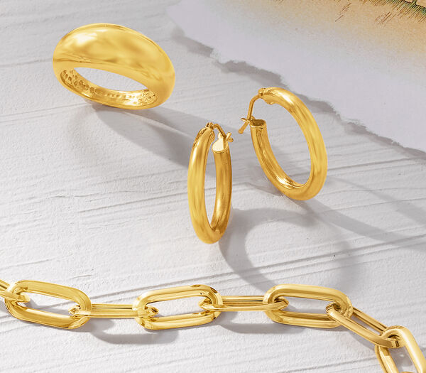 Exquisite 18kt Gold. Fine jewelry you'll wear forever. Shop 18kt Gold. Image Featuring 18kt Gold Jewelry on Marble