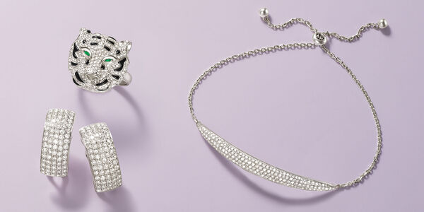 Diamond earrings, lion-head ring and bracelet.