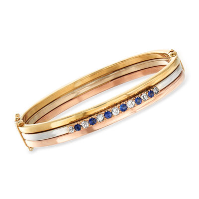 C. 1930 Vintage .60 ct. t.w. Diamond and .50 ct. t.w. Sapphire Bangle Bracelet in 14kt Tri-Colored Gold