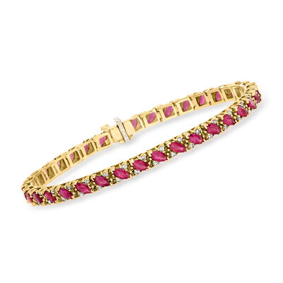 C. 1980 Vintage 7.00 ct. t.w. Ruby Line Bracelet with .75 ct. t.w. Diamonds in 14kt Yellow Gold