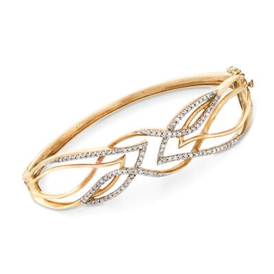 C. 1970 Vintage .85 ct. t.w. Diamond Openwork Crisscross Bangle Bracelet in 10kt Yellow Gold, , default