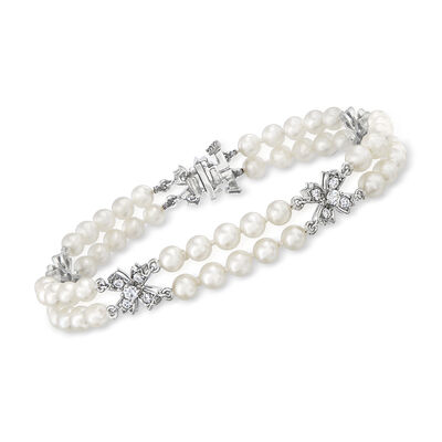 C. 1980 Vintage Tiffany Jewelry 4mm Cultured Pearl and 1.00 ct. t.w. Diamond Bow Bracelet in Platinum