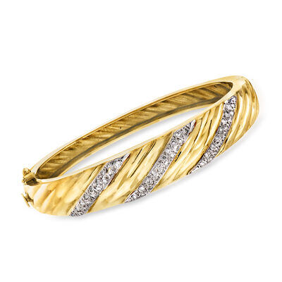 C. 1980 Vintage .75 ct. t.w. Diamond Striped Bangle Bracelet in 14kt Yellow Gold