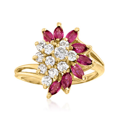 C. 1980 Vintage .75 ct. t.w. Pink Sapphire and .50 ct. t.w. Diamond Cluster Ring in 14kt Yellow Gold