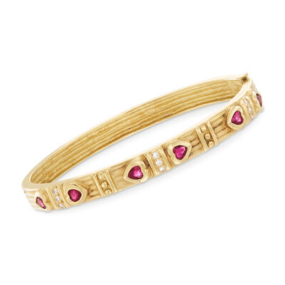 C. 1990 Vintage .90 ct. t.w. Ruby and .20 ct. t.w. Diamond Heart Bangle Bracelet in 18kt Yellow Gold, , default