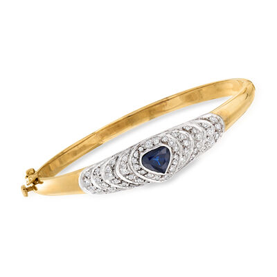 C. 1980 Vintage 1.25 Carat Sapphire and .75 ct. t.w. Diamond Heart Bangle Bracelet in 14kt Yellow Gold