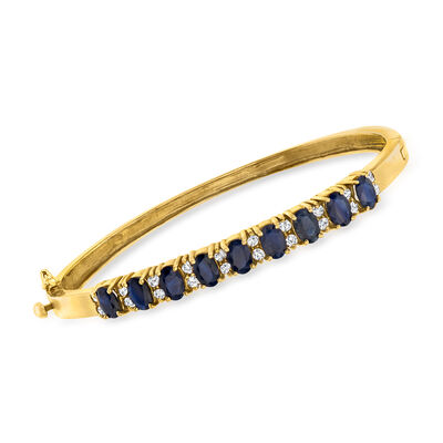 C. 1990 Vintage 2.75 ct. t.w. Sapphire and .40 ct. t.w. Diamond Bangle Bracelet in 14kt Yellow Gold
