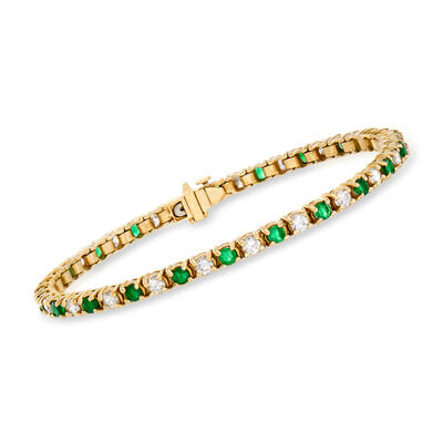 C. 1980 Vintage 2.65 ct. t.w. Diamond and 2.50 ct. t.w. Emerald Line Bracelet in 14kt Yellow Gold