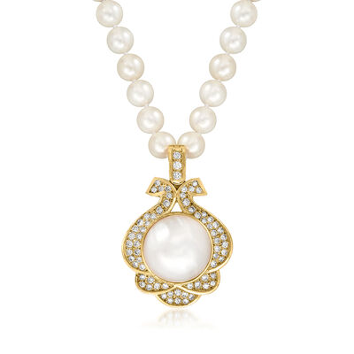 C. 1980 Vintage 17mm Cultured Mabe Pearl and 7mm Cultured Pearl Pendant Necklace with 1.50 ct. t.w. Diamonds in 14kt Yellow Gold