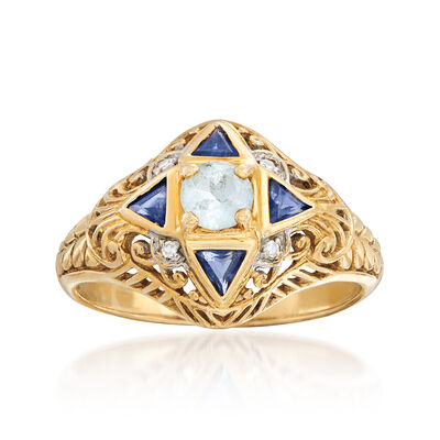 C. 1980 Vintage .25 Carat Blue Topaz and .20 ct. t.w. Sapphire Ring in 14kt Yellow Gold with Diamond Accents, , default