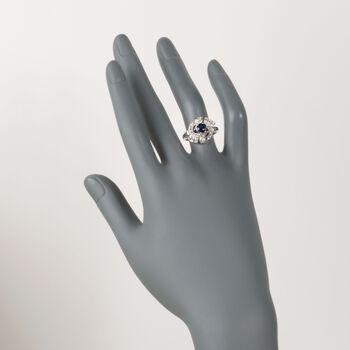 C. 1980 Vintage .70 Carat Sapphire and .35 ct. t.w. Diamond Swirl Ring in 14kt White Gold. Size 6.75, , default