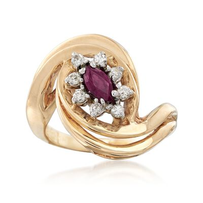 C. 1980 Vintage .25 Carat Ruby and .20 ct. t.w. Diamond Swirl Ring in 14kt Yellow Gold