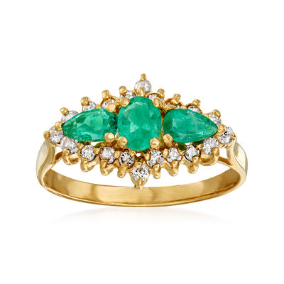 C. 1980 Vintage .65 ct. t.w. Emerald and .40 ct. t.w. Diamond Ring in 14kt Yellow Gold