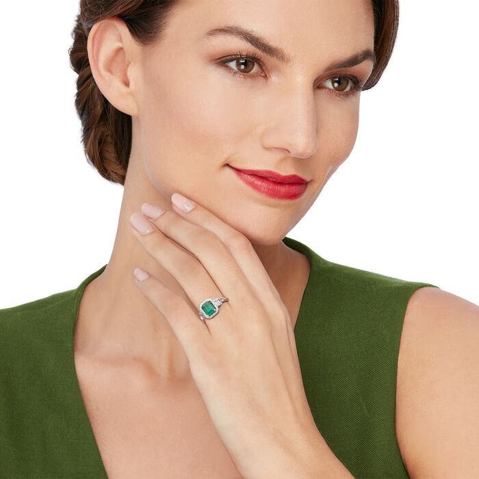 1.30 Carat Emerald and .30 ct. t.w. Baguette and Round Diamond Halo Ring in 14kt White Gold