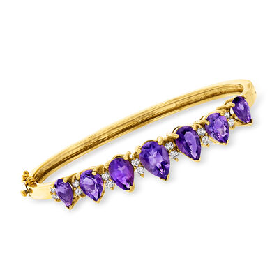 C. 1980 Vintage 6.80 ct. t.w. Amethyst and .50 ct. t.w. Diamond Bangle Bracelet in 14kt Yellow Gold