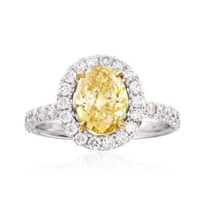 C. 2000 Vintage 1.31 Carat Fancy Yellow Diamond Ring with 1.00 ct. t.w. White Diamonds in 18kt White Gold