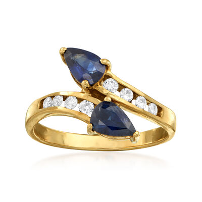 C. 1980 Vintage .95 ct. t.w. Sapphire and .20 ct. t.w. Diamond Bypass Ring in 14kt Yellow Gold, , default