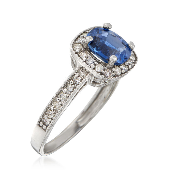 C. 2000 Vintage 1.40 Carat Sapphire and .30 ct. t.w. Diamond Halo Ring in 14kt White Gold