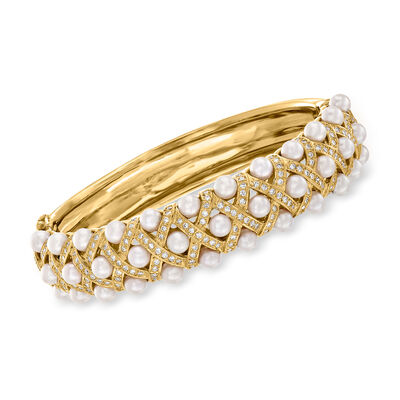 C. 1980. Vintage 4mm Cultured Pearl and 2.10 ct. t.w. Diamond Bangle Bracelet in 18kt Yellow Gold