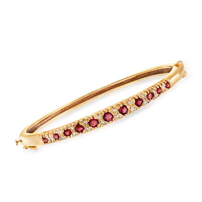 C. 1980 Vintage 1.35 ct. t.w. Ruby and .30 ct. t.w. Diamond Bangle Bracelet in 14kt Yellow Gold