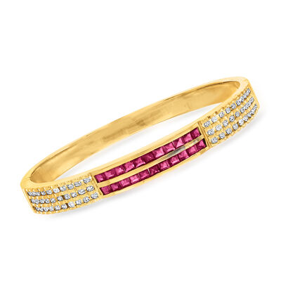 C. 1980 Vintage 3.30 ct. t.w. Ruby and 1.35 ct. t.w. Diamond Bangle Bracelet in 18kt Yellow Gold