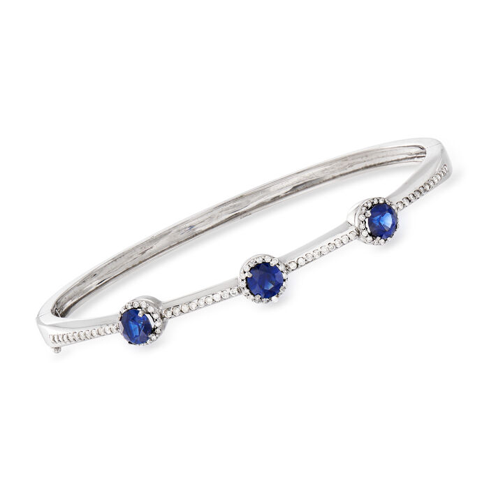 "C. 1990 Vintage 1.65 ct. t.w. Sapphire and .60 ct. t.w. Diamond Station Bangle Bracelet in 14kt White Gold. 7"", , default"