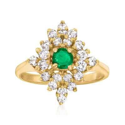 C. 1980 Vintage .30 Carat Emerald Ring with .75 ct. t.w. Diamonds in 14kt Yellow Gold