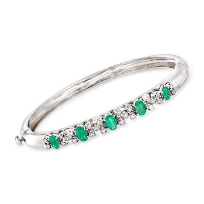 C. 1990 Vintage 1.93 ct. t.w. Emerald and .85 ct. t.w. Diamond Bangle Bracelet in 18kt White Gold