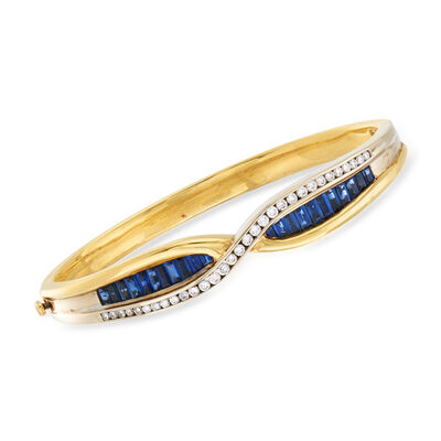 C. 1980 Vintage 3.30 ct. t.w. Sapphire and .85 ct. t.w. Diamond Crossover Bangle Bracelet in 18kt Yellow Gold